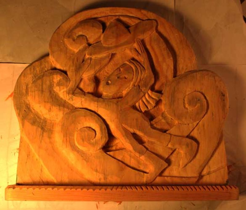 Wind Blowing Hat off head carved