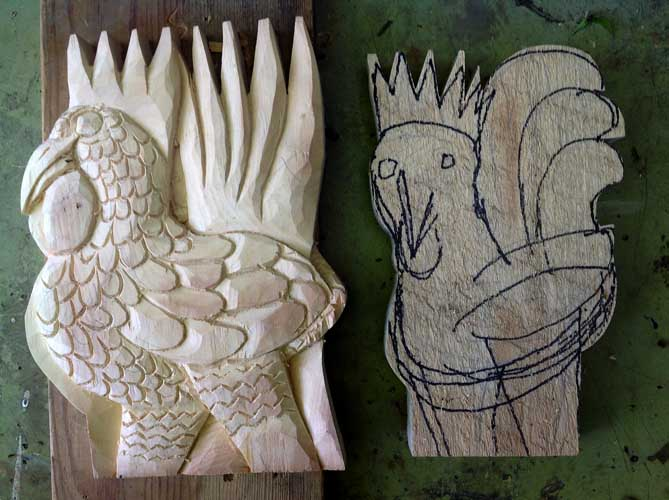 Two roosters one carved
