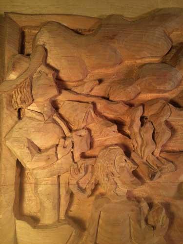 Carved guy on left