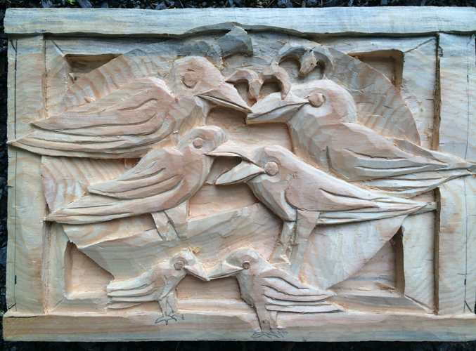 Crows carved